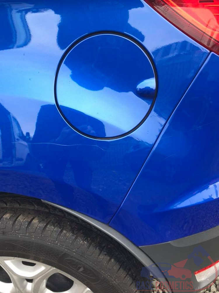 Deep scratches to the quarter panel and rear bumper (sorry picture not the best).